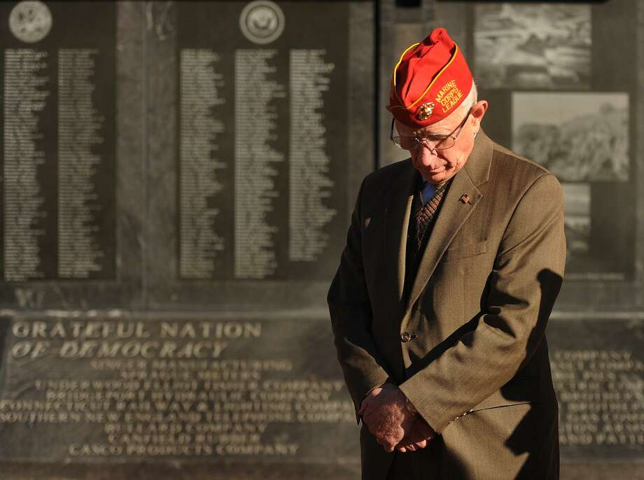 Thomas Kanasky, of Bridgeport, president of the Greater Bridgeport Veterans Council, bows his head during the Pearl Harbor Remembrance Ceremony on the 76th anniversary of the Pearl Harbor attack at the World War II Memorial on Broad Street in Bridgeport, Conn. on Thursday, December 7, 2017. Photo: Brian A. Pounds / Hearst Connecticut Media / Connecticut Post