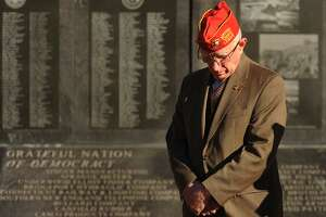 Thomas Kanasky, of Bridgeport, president of the Greater Bridgeport Veterans Council, bows his head during the Pearl Harbor Remembrance Ceremony on the 76th anniversary of the Pearl Harbor attack at the World War II Memorial on Broad Street in Bridgeport, Conn. on Thursday, December 7, 2017.