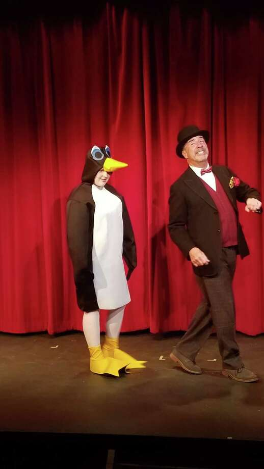 Mr. Popper (Bob Filipowich) takes his penguin Captain Cook (Alexis Taylor) out for a stroll. Photo: Contributed Photo / New Canaan News