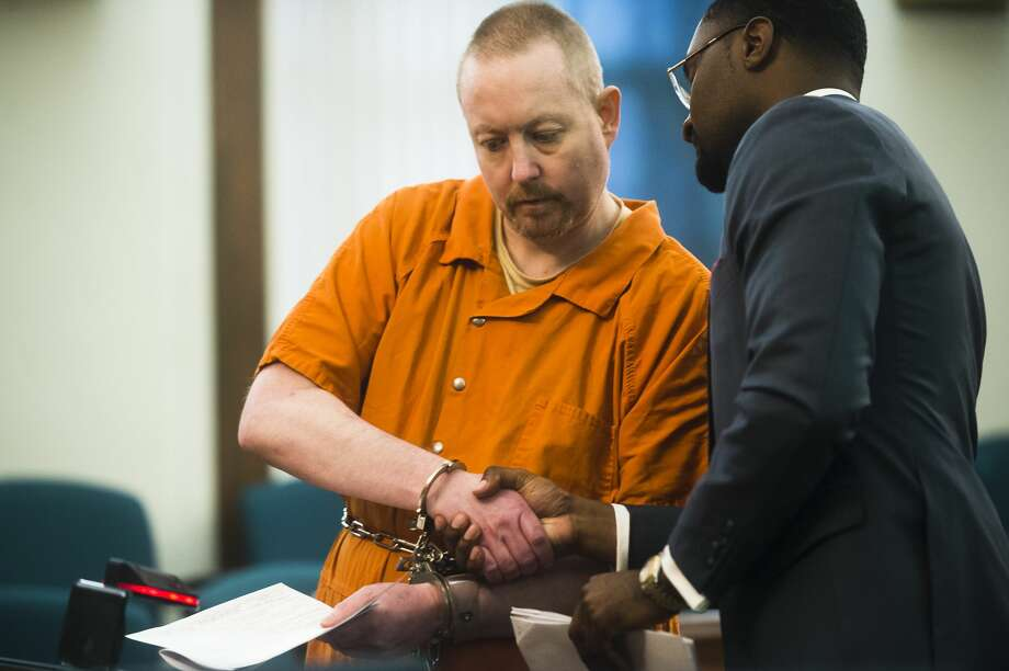 Richard Paul Watson shakes the hand of his attorney, Alan A. Crawford, on Thursday, Dec. 7, 2017 during his sentencing on two charges in connection with the 2015 death of 4-month-old Evelyn Legacy. (Katy Kildee/kkildee@mdn.net) Photo: (Katy Kildee/kkildee@mdn.net)