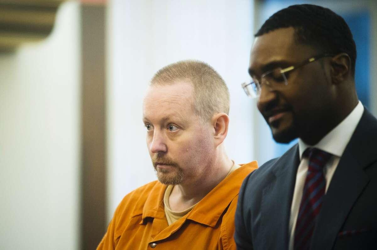 Richard Paul Watson listens to Midland County Circuit Court Judge Michael J. Beale on Thursday, Dec. 7, 2017 during his sentencing on two charges in connection with the 2015 death of 4-month-old Evelyn Legacy. (Katy Kildee/kkildee@mdn.net)
