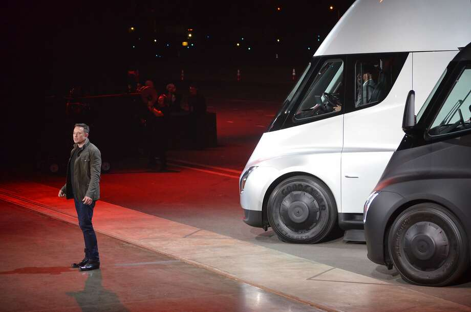 """Tesla Chairman and CEO Elon Musk unveils the new """"Semi"""" electric Truck for buyers and journalists on November 16, 2017 in Hawthorne, California, near Los Angeles.  / AFP PHOTO / Veronique DUPONTVERONIQUE DUPONT/AFP/Getty Images Photo: VERONIQUE DUPONT, AFP/Getty Images"""