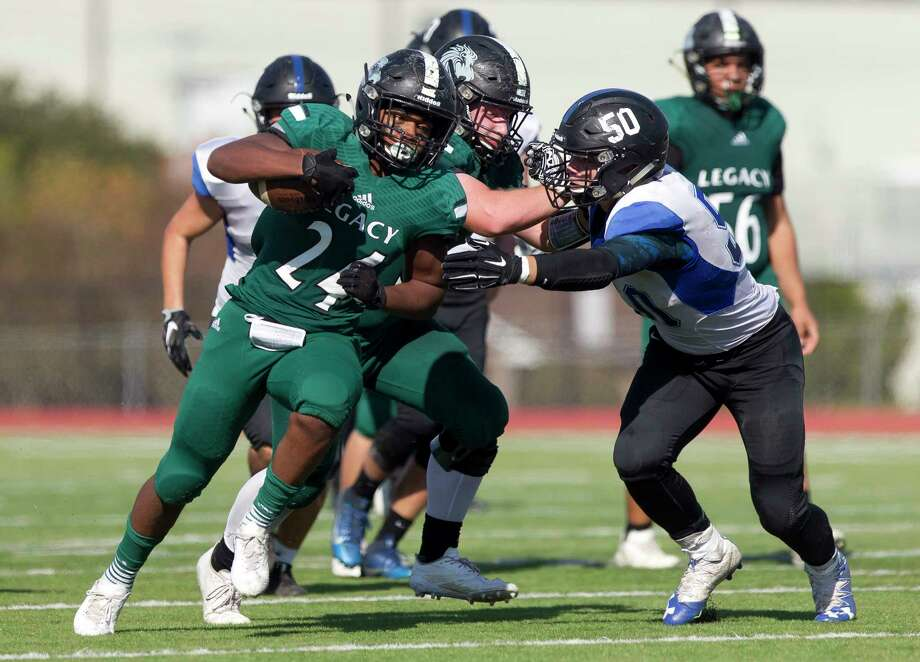 Legacy Prep running back Dion Pinkard (24) breaks a tackle by Brazos Christian linebacker Garrett Fowler (50) to score on a 19-yard run during the fourth quarter of a TAPPS Division IV state semifinal game at Cub Stadium, Saturday, Dec. 2, 2017, in Brenham. Photo: Jason Fochtman, Staff Photographer / © 2017 Houston Chronicle