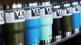 Yeti ramblers are shown during a product unveiling party at the company's signature store in June in Austin. Texas Attorney General Ken Paxton is suing a San Antonio man for allegedly selling counterfeit Yeti products.