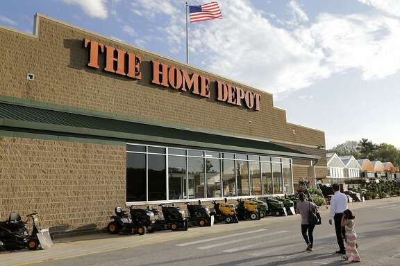 FILE - In this Wednesday, May 18, 2016, file photo, people approach an entrance to a Home Depot store in Bellingham, Mass. Home Depot is sticking by its outlook for the year and will buy back $15 billion in company shares. The Home Depot Inc. laying out its strategy to investors Wednesday, Dec. 6, 2017, with CEO Craig Menear saying that the retail landscape is changing at an unprecedented pace. (AP Photo/Steven Senne, File)