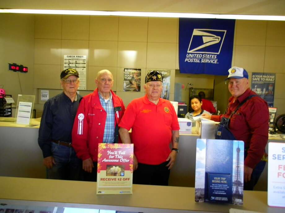 Post leadership from left is Lee Krigar, finance officer; Wilbert Winkelmann, 1st Vice Commander; Jerry Killion, Adjutant; in the background, Cindy Nuygen, U.S. Postal Employee; and Ron Heinen, Chaplain. Photo: Submitted