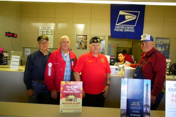 Post leadership from left is Lee Krigar, finance officer; Wilbert Winkelmann, 1st Vice Commander; Jerry Killion, Adjutant; in the background, Cindy Nuygen, U.S. Postal Employee; and Ron Heinen, Chaplain.