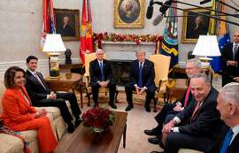 US President Donald Trump, alongside Vice President Mike Pence (3L), meets with Congressional leadership including Senate Majority Leader Mitch McConnell (3R), Republican of Kentucky, Senate Minority Leader Chuck Schumer (2R), Democrat of New York, Speaker of the House Paul Ryan (2nd L), Republican of Wisconsin, and House Democratic Leader Nancy Pelosi (L), Democrat of California, and Secretary of Defense Jim Mattis (R), in the Oval Office at the White House in Washington, DC, December 7, 2017. / AFP PHOTO / SAUL LOEBSAUL LOEB/AFP/Getty Images