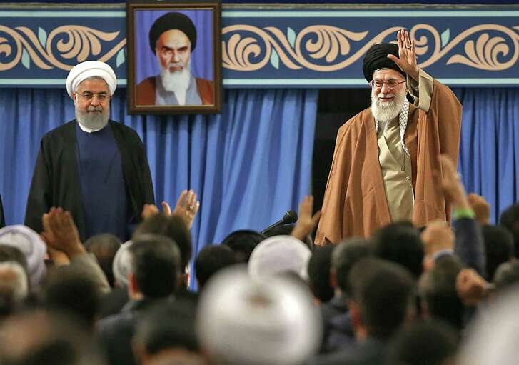 Iran's supreme leader Ayatollah Ali Khamenei on Dec. 6, 2017 waves next to President Hassan Rouhani during a meeting with the Iranian government in the capital Tehran. Obsession with Iran is spoiling chances for meaningful reform in the Mideast.