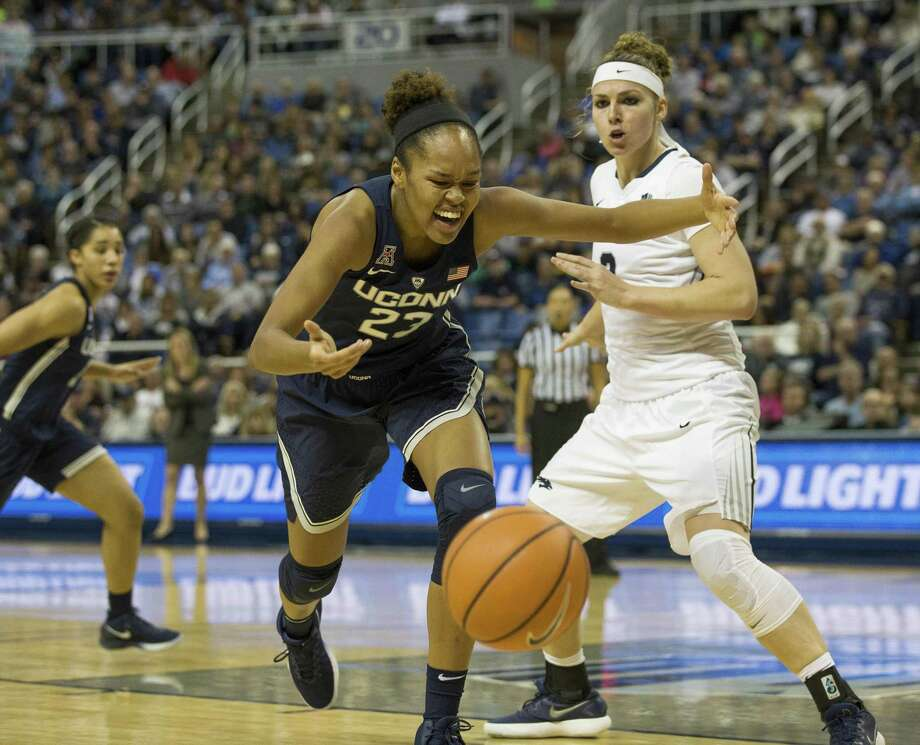 Azura Stevens, left, and the UConn women's basketball team play at DePaul on Friday. Photo: Associated Press File Photo / FR171463 AP