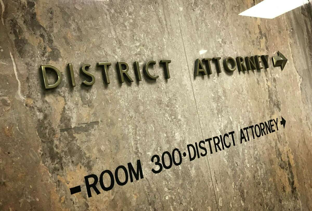 A sign points to the District Attorney's Office on the third floor of the San Francisco Hall of Justice.