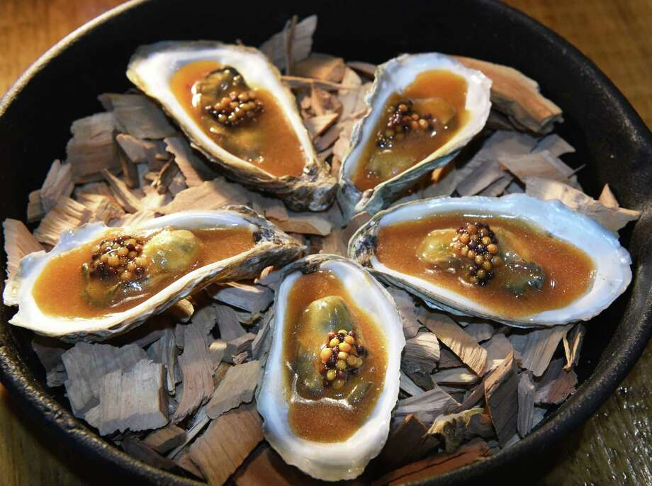 Smoked oysters at the Lost & Found restaurant on Broadway Tuesday Dec. 5, 2017 in Albany, NY.  (John Carl D'Annibale / Times Union) Photo: John Carl D'Annibale / 20042310A