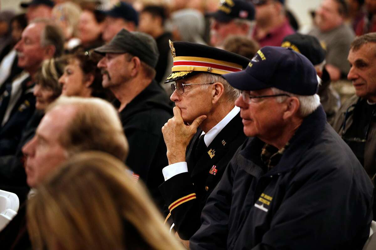 Retired Army Lt. Colonel Dick Wenzel listens to the presentations during a ceremony on the 76th anniversary of the bombing of Pearl Harbor aboard the USS Hornet on Thursday December 7, 2017, in Alameda, Calif.