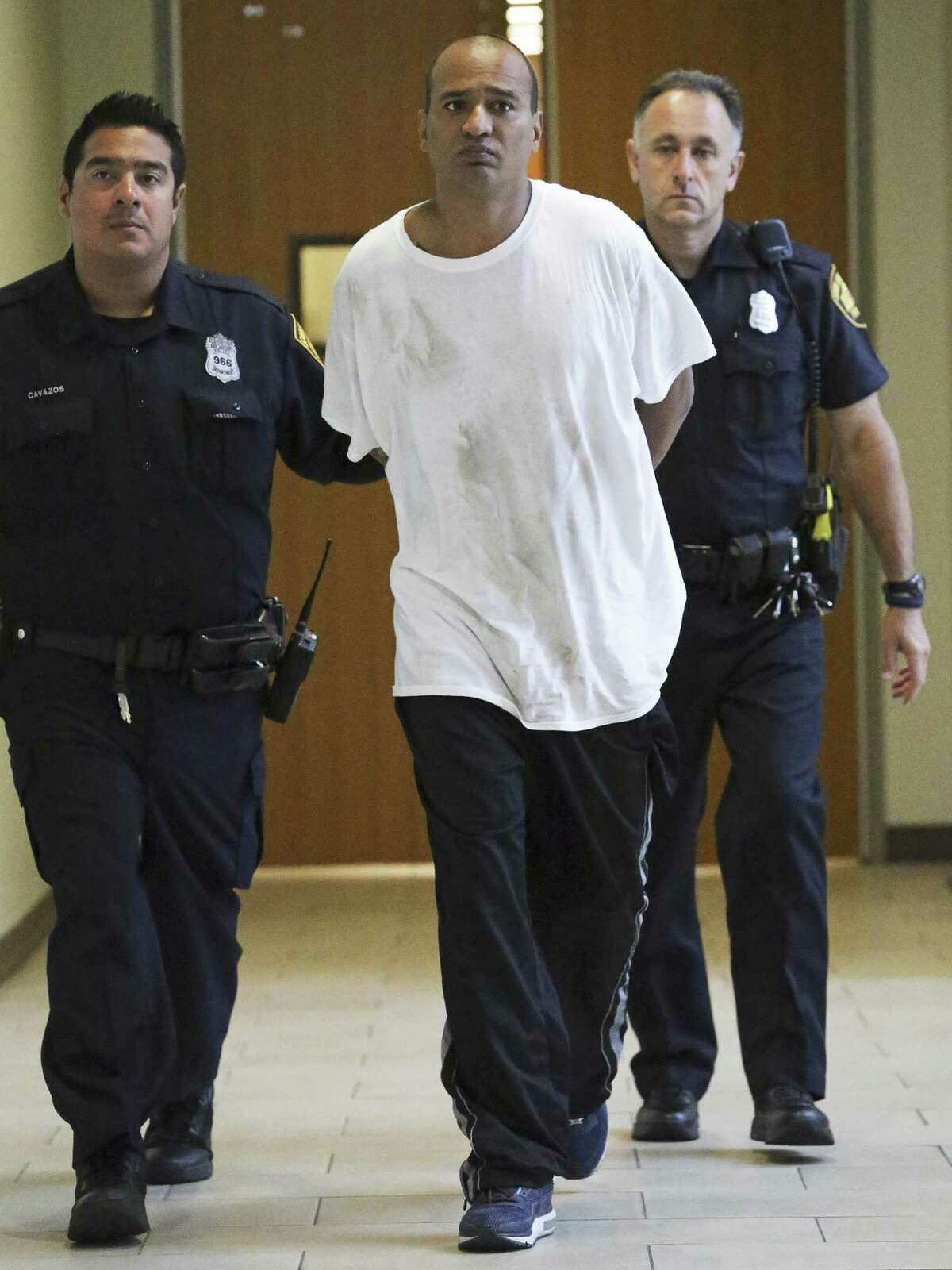 James Edward Striblin is led out of police headquarters after his arrest on July 27, 2016