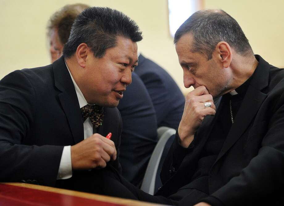 State Senator Tony Hwang, R-Fairfield, left, talks with Bishop Frank Caggiano of the Bridgeport Diocese at the meeting of the Coalition Against Casino Expansion at The Catholic Center in Bridgeport on Thursday. The coalition opposes casino expansion in Bridgeport. Photo: Brian A. Pounds / Hearst Connecticut Media / Connecticut Post