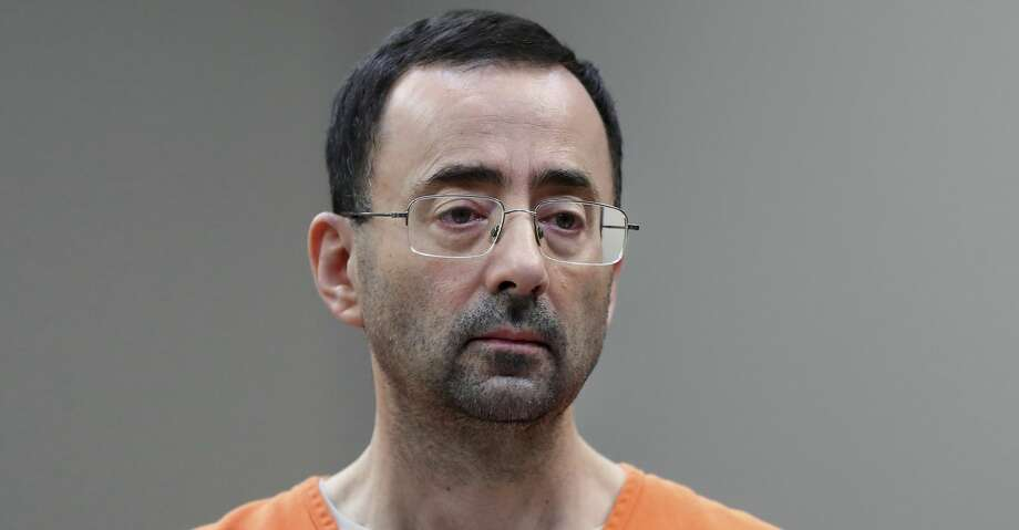In this Nov. 22, 2017 file photo, Dr. Larry Nassar, 54, appears in court for a plea hearing in Lansing, Mich. Nasser, a sports doctor accused of molesting girls while working for USA Gymnastics and Michigan State University pleaded, guilty to multiple charges of sexual assault and will face at least 25 years in prison.(AP Photo/Paul Sancya) Photo: Paul Sancya/Associated Press