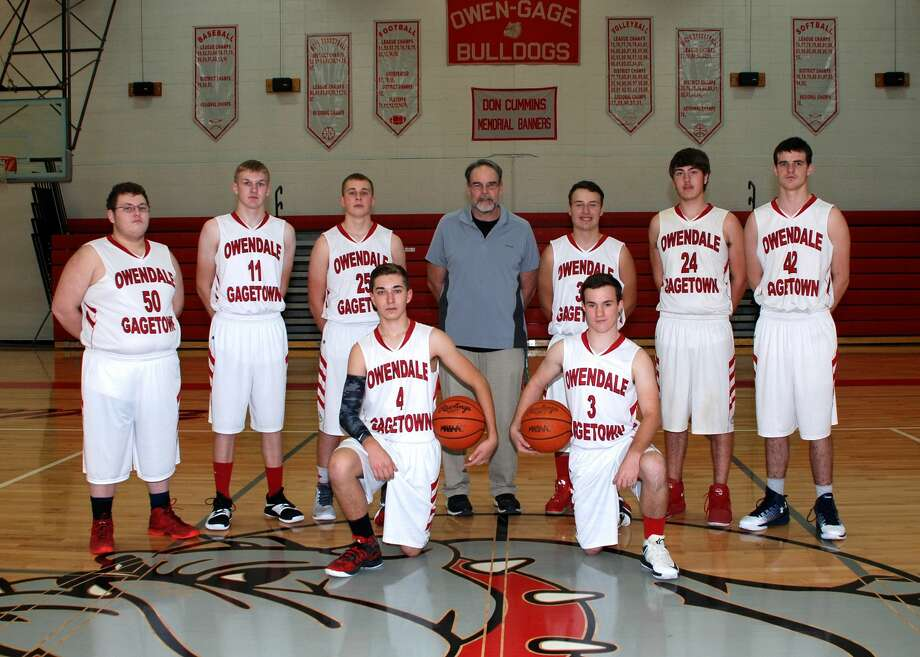 Members of the Owendale-Gagetown boys varsity basketball team are (front row from left) Matthew Fritz and Cordell Clarkson (back row) Michael Ray, Aaron Fahrner, Luke Retford, Coach Brian Wright, Carl Steff, Ben Schultz, and Brandon Binder. Photo: Julie Warack/For The Tribune
