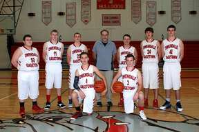 p.p1 {margin: 0.0px 0.0px 0.0px 0.0px; font: 18.0px Calibri} span.s1 {font-kerning: none}   Members of the Owendale-Gagetown boys varsity basketball team are (front row from left) Matthew Fritz and Cordell Clarkson (back row) Michael Ray, Aaron Fahrner, Luke Retford, Coach Brian Wright, Carl Steff, Ben Schultz, and Brandon Binder.