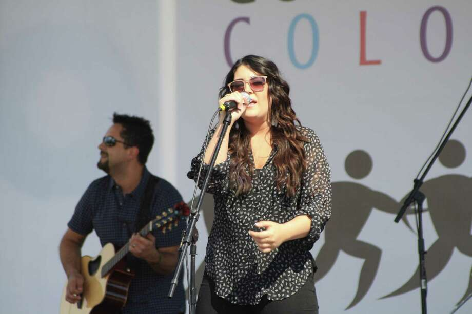 Special guest Kree Harrison performed in a mini-concert at the end of the Compassion Color 5K on Saturday. Bands Matthew Lewis and Flava opened for Harrison. Photo: Jose D. Enriquez III / Internal