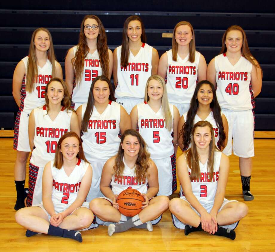 Members of the Unionville-Sebewaing Area girls varsity basketball team are (front row from left) Laken Polega, Lauren Adam and Katelyn Engelhardt (middle row) Baillie Fritz, Delanie Pavlichek, Nichole Schemer and Morgan Martinez (back row) Brianna Osantowske, Alexandra LaLonde, Rylee Zimmer, Brynn Polega and Reigen Ryan.  Photo: Paul P. Adams/Huron Daily Tribune