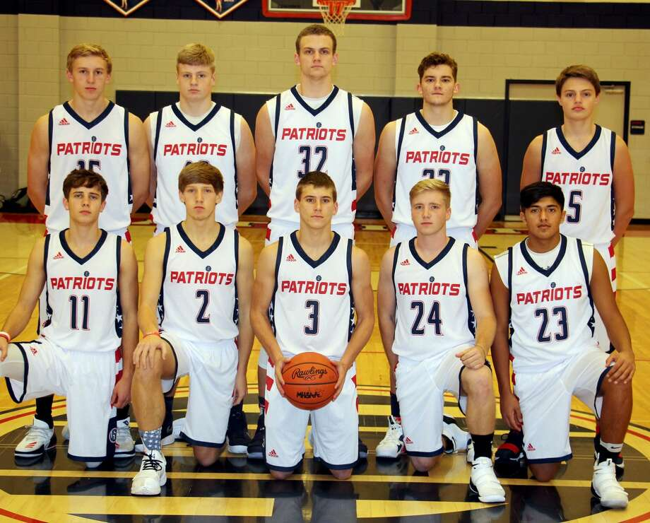 Members of the Unionville-Sebewaing Area boys varsity basketball team are (front row from left) Micah Cramer, Tyler Heckroth, Hunter Bohn, Rocky Hahn and Cruz Fernandez (back row) Kyle Maust, Keegan Birman, Isaiah Williamson, Zach Fritz and Landin Zimmer.  Photo: Paul P. Adams/Huron Daily Tribune
