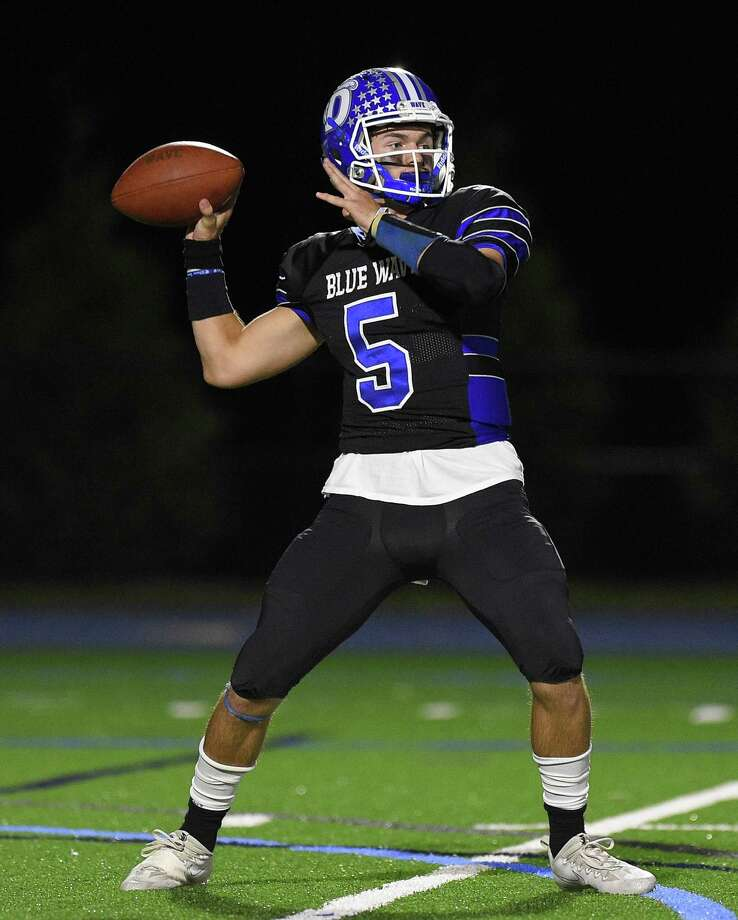 Darien quarterback Jack Joyce ran for two touchdowns in his team's semifinal-round win against West Haven in the Class LL semifinals. Photo: Matthew Brown / Hearst Connecticut Media / Stamford Advocate