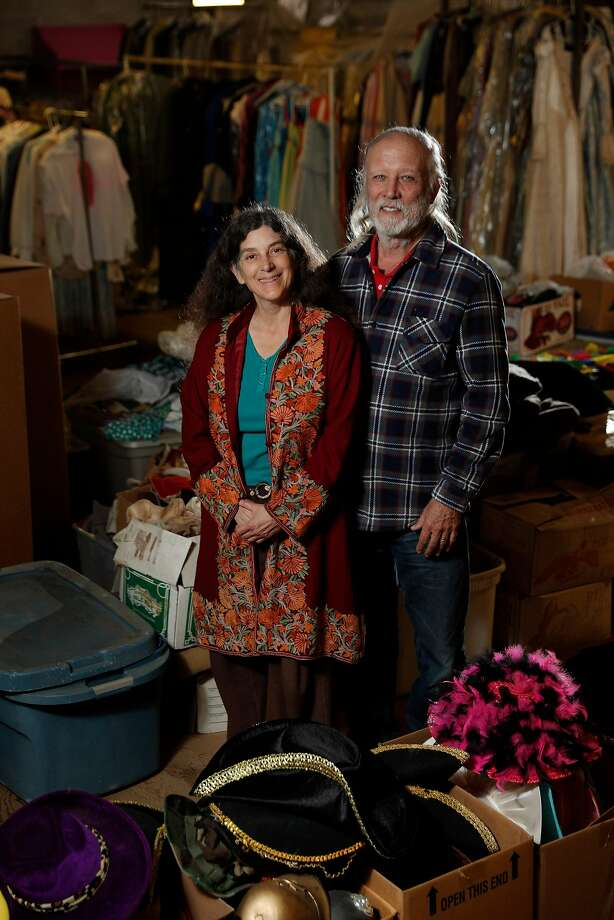 Lesley Currier (left) and her husband, Robert Currier, are surrounded by Marin Shakespeare Company costumes in a storage area at their new, year-round downtown theater space in San Rafael. Photo: Carlos Avila Gonzalez, The Chronicle