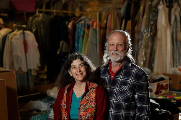 Lesley Currier, left, and her husband Robert Currier, in the upstairs storage area with Marin Shakespeare's costumes at the new, year-round downtown theater space in San Rafael, Calif., on Wednesday, November 15, 2017.  Marin Shakespeare Company is slowly opening a new space that combines a performance venue, classrooms and office space. The space is still a work-in-progress.