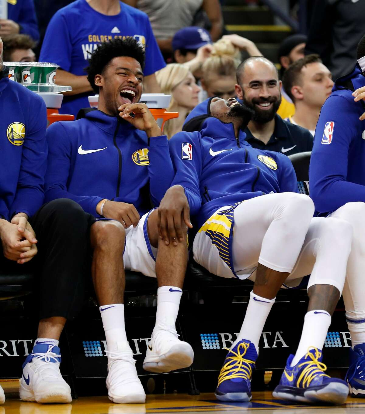 Golden State Warriors' Quinn Cook and Kevin Durant laugh in the 4th quarter of a Warriors' 110-100 win at Oracle Arena in Oakland on Monday, November 13, 2017.