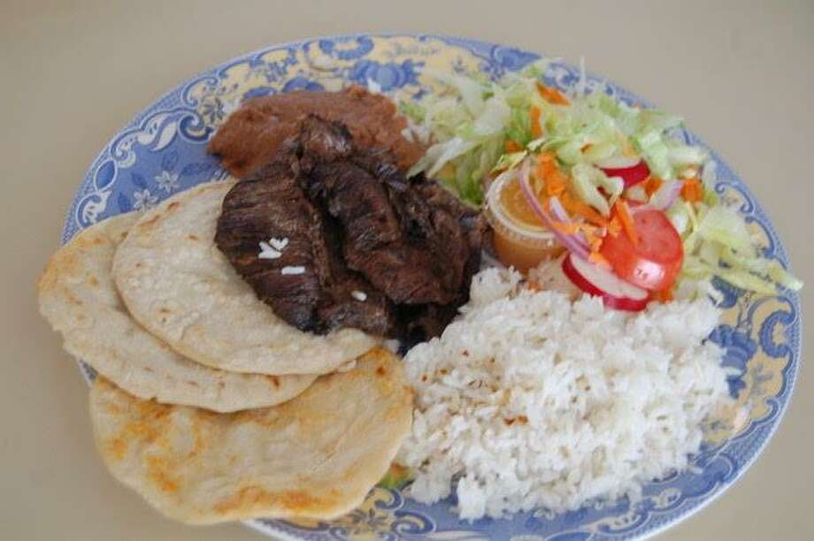 A hearty beef dish at El Sabor Salvadoreno Restaurante in Norwalk. Photo: Jane Stern / For Hearst Media Group