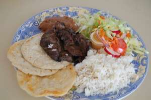 A hearty beef dish at El Sabor Salvadoreno Restaurante in Norwalk.