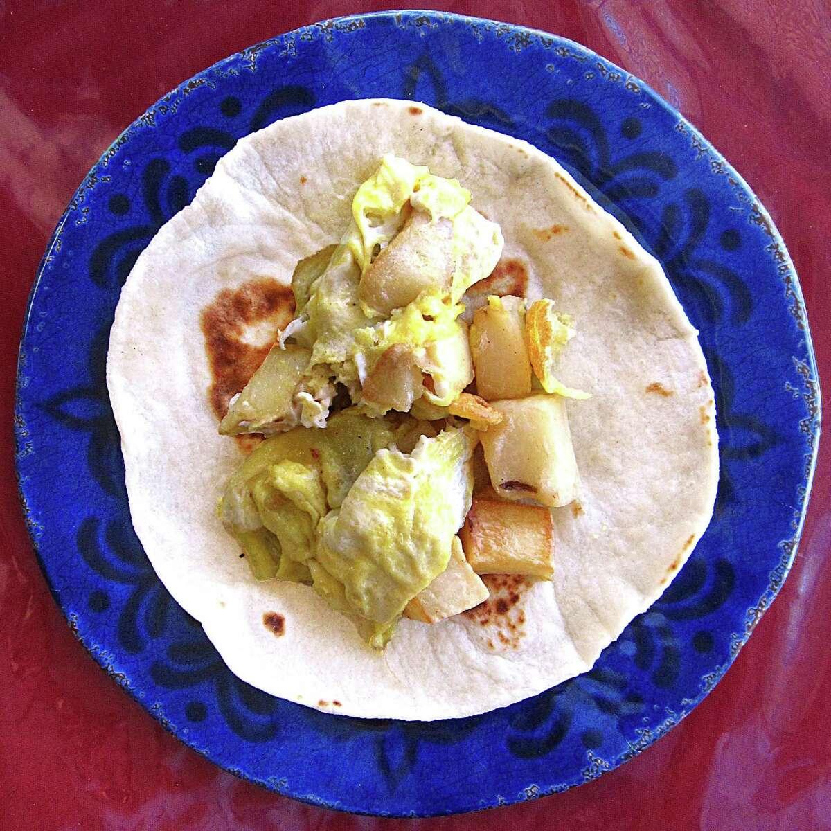 Potato and egg taco on a handmade flour tortilla from Peter El Norteño.