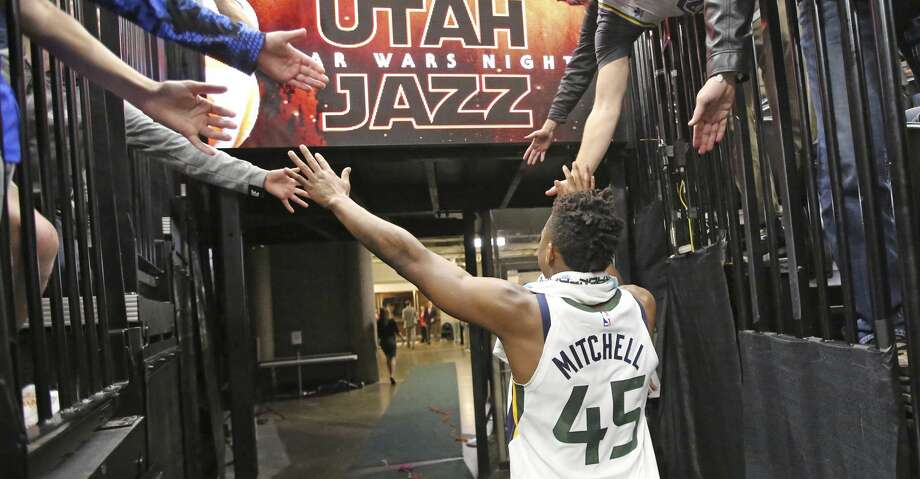 Utah Jazz guard Donovan Mitchell (45) celebrates with fans following their NBA basketball game against the New Orleans Pelicans Friday, Dec. 1, 2017, in Salt Lake City. The Jazz won 114-108. Mitchell scored 41 points. (AP Photo/Rick Bowmer) Photo: Rick Bowmer/Associated Press