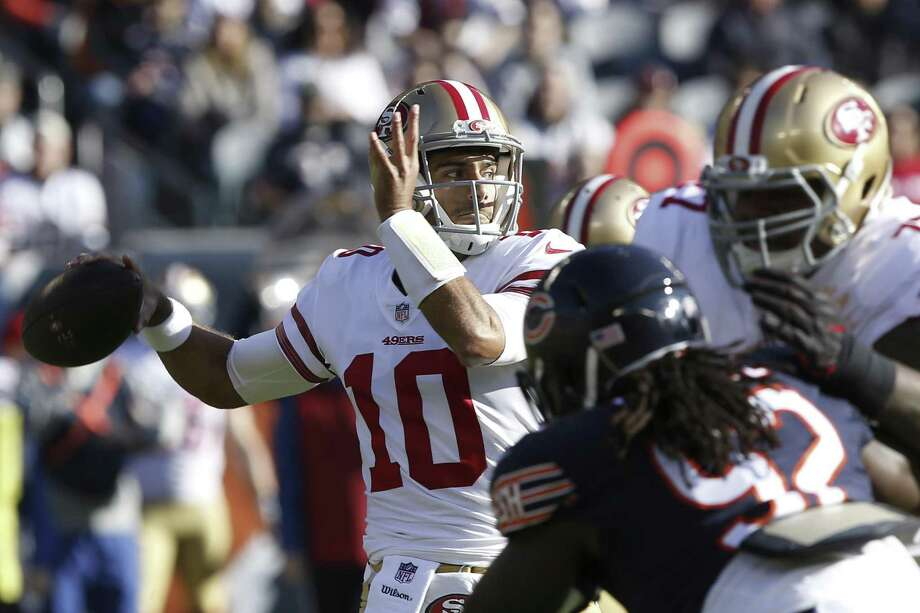 CHICAGO, IL - DECEMBER 03:  Quarterback  Jimmy Garoppolo #10 of the San Francisco 49ers looks to pass the football in the first quarter against the Chicago Bears at Soldier Field on December 3, 2017 in Chicago, Illinois. The San Francisco 49ers defeated the Chicago Bears 15-14.  (Photo by Kena Krutsinger/Getty Images) Photo: Kena Krutsinger / Getty Images / 2017 Getty Images
