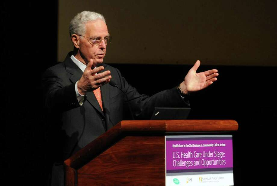 Uwe Reinhardt, a world-renowned health economist from Princeton University, delivers his speech, U.S. Health Care under Siege: Challenges and Opportunities, at UAlbany on Tuesday Nov. 19, 2013 in Albany, N.Y. (Michael P. Farrell/Times Union) Photo: Michael P. Farrell, Staff Photographer / ONLINE_YES