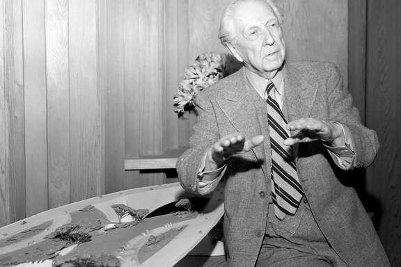 "April 23, 1955: Famed architect Frank Lloyd Wright poses with his ""Butterfly Bridge"" design in 1955. The bridge was designed as an unbuilt southern crossing between San Francisco and the East Bay."