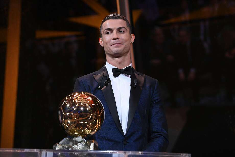 Cristiano Ronaldo poses with his record-tying fifth Ballon d'Or trophy as the world's best player for last season. Photo: FRANCK FAUGERE, AFP/Getty Images