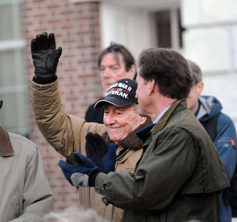 World War II Army veteran Archie Russell, 93, waves after being honored during the Town of Greenwich Pearl Harbor Remembrance Day 76th anniversary ceremony in front of town hall in Greenwich, Conn., Thursday, Dec. 7, 2017. Photo: Bob Luckey Jr. / Hearst Connecticut Media / Greenwich Time