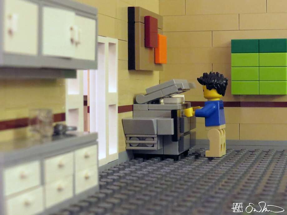 Sensing his hands get warm on the active copy machine, the grad student is unexpectedly reminded of how lonely he is. Photo: Lego Grad Student