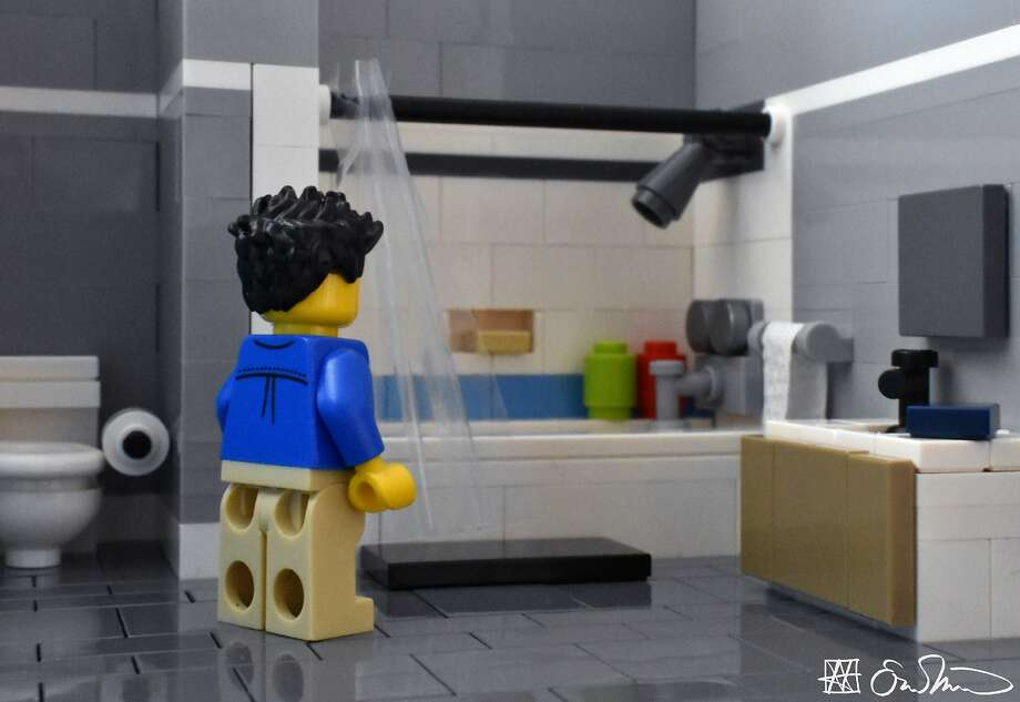 Getting ready to take a shower, the grad student identifies one place where he can conceal his tears. Photo: Lego Grad Student