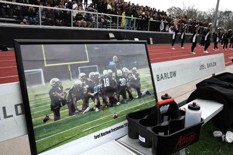 A picture of the late Barlow coach Jordan Wright sits on the bench during the Joel Barlow and SMSA Class M state football semifinal, at Joel Barlow in Redding, December 3, 2017. Barlow beat SMSA 53-14 to reach the Class M final. Wright died in November 2016 after a long battle with bone cancer. Photo: Krista Benson / For Hearst Connecticut Media / The News-Times Freelance