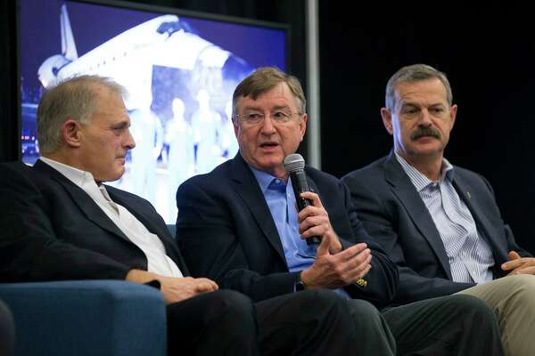 Oribital ATK's Frank Culbertson, Jr. (center), a veteran astronaut, speaks on a panel featuring astronauts, including Dave Wolf (left) and Scott Altman (right), who have transitioned to the business world during the third annual Space Commerce Conference and Exposition, SpaceCom, Thursday, Dec. 7, 2017, in Houston. All of the astronauts on the panel have made the transition to business world relating to space. ( Mark Mulligan / Houston Chronicle )