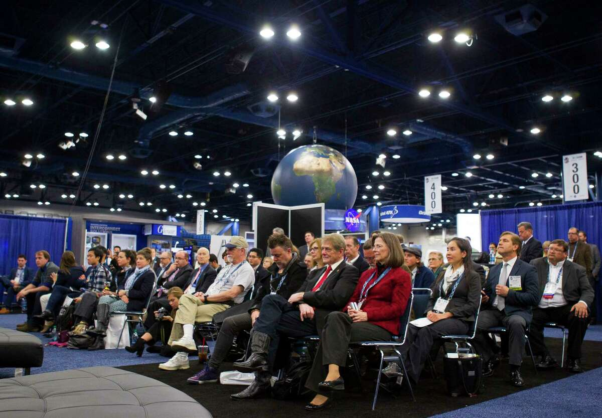 The crowd listens to a panel of former astronauts during the third annual Space Commerce Conference and Exposition, SpaceCom, Thursday, Dec. 7, 2017, in Houston. All of the astronauts on the panel have made the transition to business world relating to space. ( Mark Mulligan / Houston Chronicle )