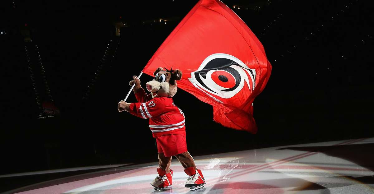 RALEIGH, NC - NOVEMBER 15: Stormy, mascot of the Carolina Hurricanes waves the team logo flag prior to an NHL game against the San Jose Sharks on November 15, 2016 at PNC Arena in Raleigh, North Carolina. (Photo by Gregg Forwerck/NHLI via Getty Images)