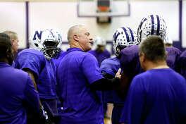 Newton offensive coordinator Greg Neece talks with players during practice on Wednesday. Photo taken Wednesday 12/6/17 Ryan Pelham/The Enterprise