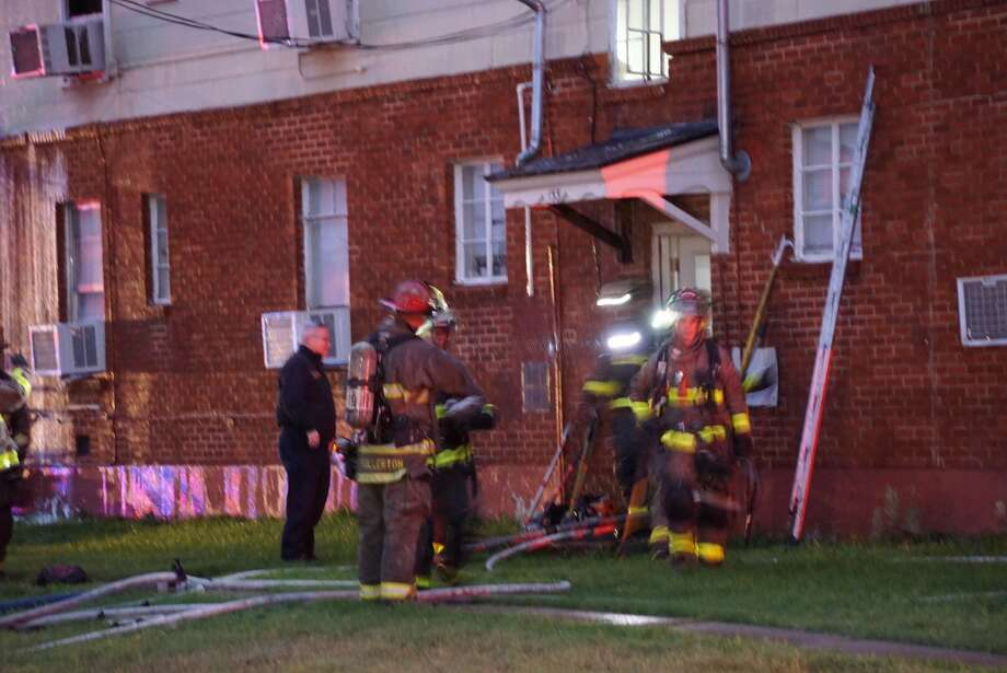 Firefighters found a 39-year-old man dead after a fire at a Southwest Side apartment complex between Gillmore and Cropsey avenues Thursday Dec. 7, 2017. Photo: Jacob Beltran