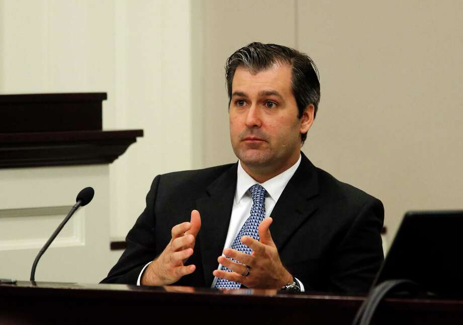 FILE - In a Nov. 29, 2016 file photo, former North Charleston police officer Michael Slager testifies during his murder trial at the Charleston County court in Charleston, S.C. Slager was sentenced to 20 years in prison Thursday, Dec. 7, 2017, for 2015 fatal shooting of unarmed black motorist Walter Scott. (Grace Beahm/Post and Courier via AP, Pool, File) Photo: Grace Beahm, POOL / Pool Charleston Post and Courier