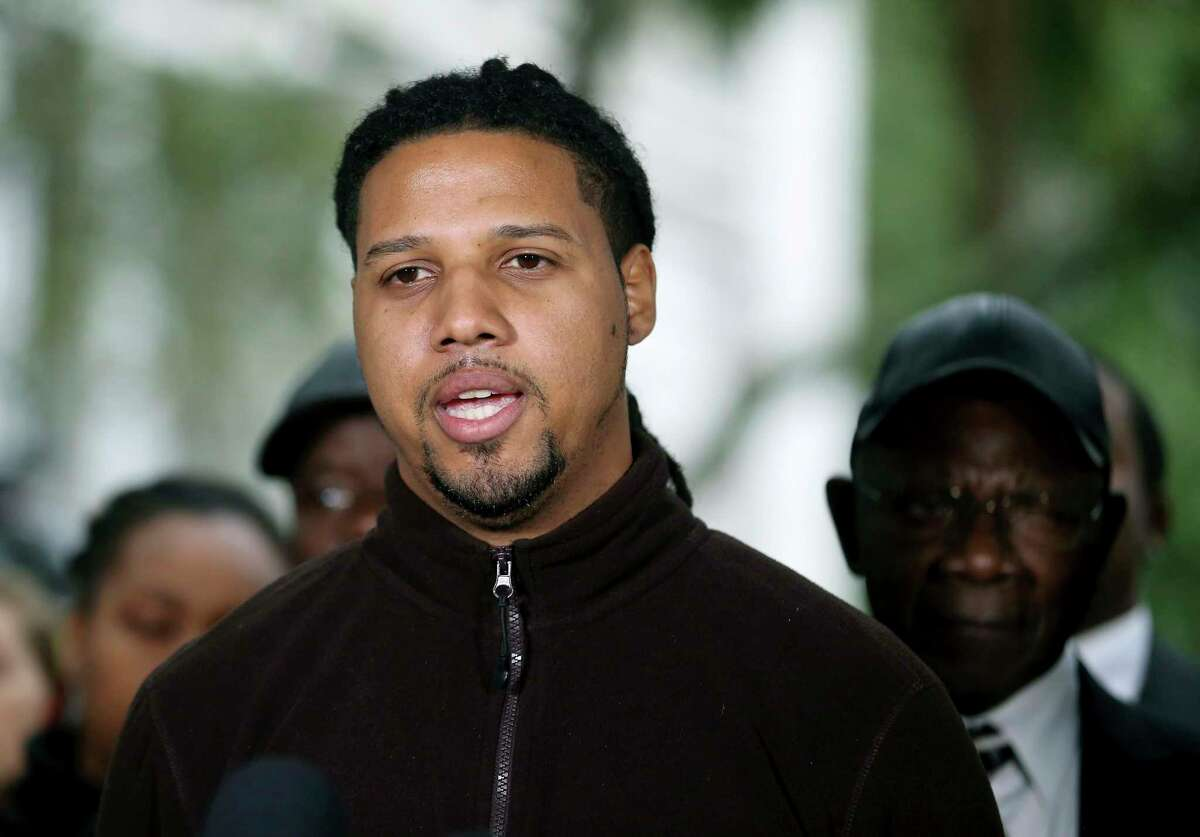 Feiden Santana, who made the cell video showing former North Charleston Police Officer Michael Slager's fatal encounter with Walter Scott, talks with the press after Slager was sentenced to 20 years in prison for the 2015 shooting death of Scott Thursday, Dec. 7, 2017, in Charleston, S.C. (Grace Beahm Alford/The Post And Courier via AP)