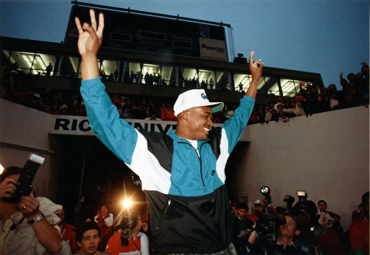 12/02/1989 - Andre Ware greets the crowd at Rice Stadium shortly after hearing the announcement that he had won the Heisman Trophy. Ware climbed an equipment cart and proclaimed to the crowd: