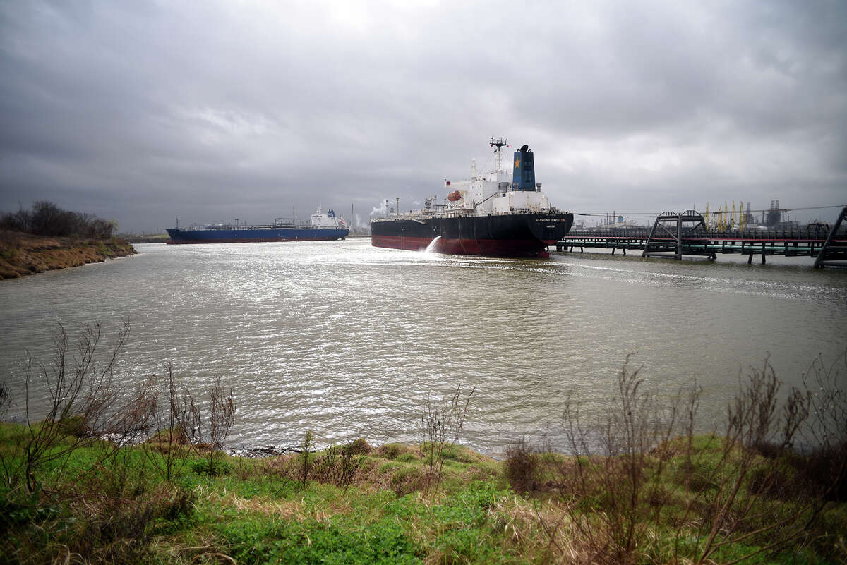 A vessel pumps out ballast as it's loaded with diesel at a dock on the Houston Ship Channel.